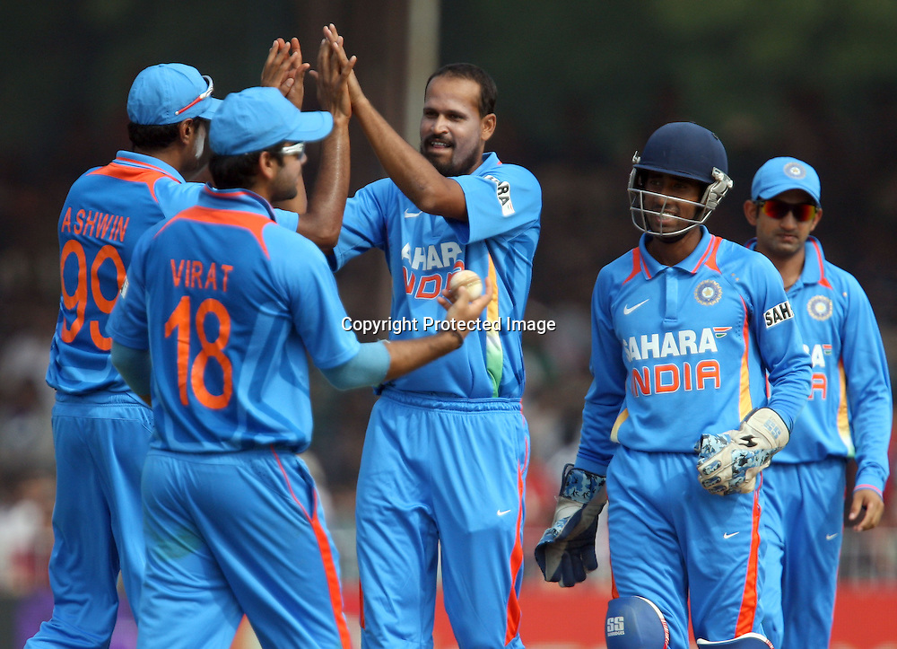 Indian bowler Yusuf Pathan celebrates with team mates after taken New Zealand captain Daniel Vettori wicket during the India vs New Zealand Played at Reliance Stadium, Vadodara, 4 December 2010 (50-over match)