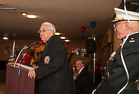 Father Steve Rock addresses Marines and guest gathered at Pheasant Ridge Saturday evening for the 239th birthday celebration of the Marine Corp.  (Karen Bobotas/for the Laconia Daily Sun)