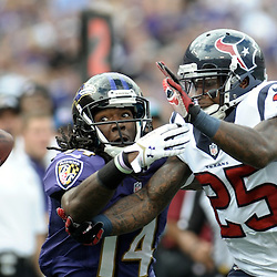 Houston Texans defensive back KAREEM JACKSON (25) breaks up the pass that was intended for Baltimore Ravens wide receiver MARLON BROWN (14) during the second quarter at M&T Stadium in Baltimore, Maryland. Baltimore leads Houston 17-9 at the half.