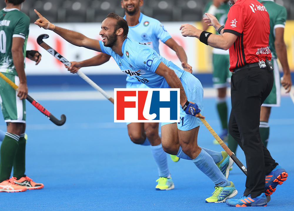 LONDON, ENGLAND - JUNE 24:  Ramandeep Singh of India celebrates scoring their teams fourth goal during the 5th-8th place match between Pakistan and India on day eight of the Hero Hockey World League Semi-Final at Lee Valley Hockey and Tennis Centre on June 24, 2017 in London, England.  (Photo by Steve Bardens/Getty Images)