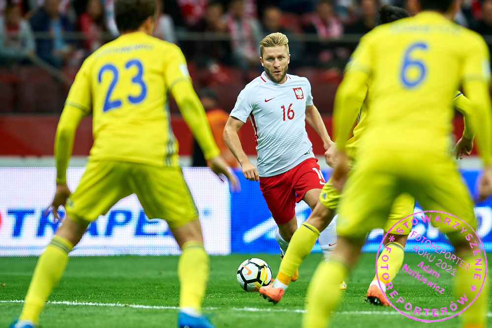 Warsaw, Poland - 2017 September 04: (C) Jakub Blaszczykowski from Poland fights for the ball during soccer match Poland v Kazakhstan - FIFA 2018 World Cup Qualifier at PGE National Stadium on September 04, 2017 in Warsaw, Poland.<br /> <br /> Adam Nurkiewicz declares that he has no rights to the image of people at the photographs of his authorship.<br /> <br /> Picture also available in RAW (NEF) or TIFF format on special request.<br /> <br /> Any editorial, commercial or promotional use requires written permission from the author of image.<br /> <br /> Mandatory credit:<br /> Photo by &copy; Adam Nurkiewicz / Mediasport