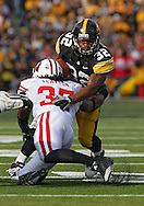 October 23 2010: Iowa Hawkeyes running back Adam Robinson (32) is hit by Wisconsin Badgers linebacker Kevin Claxton (37) during the first half of the NCAA football game between the Wisconsin Badgers and the Iowa Hawkeyes at Kinnick Stadium in Iowa City, Iowa on Saturday October 23, 2010. Wisconsin defeated Iowa 31-30.