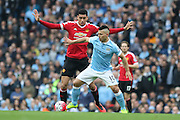Manchester City forward Sergio Aguero (10) battles with Chris Smalling of Manchester United during the Barclays Premier League match between Manchester City and Manchester United at the Etihad Stadium, Manchester, England on 20 March 2016. Photo by Phil Duncan.
