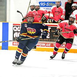 TRENTON, ON  - FEB 23,  2018: Ontario Junior Hockey League game between the Trenton Golden Hawks and the Wellington Dukes, Jeffrey Burridge #19 of the Wellington Dukes skates up ice as Max Ewart #51 of the Trenton Golden Hawks pursues the play.<br /> (Photo by Ed McPherson / OJHL Images)