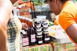 "Honey and stewed fruits.  ""Alvin's Cultural Workshop"" Cultural Fair honoring Mr. Alvin Turnbull.  Emancipation Garden.  St. Thomas, VI.  29 April 2015.  © Aisha-Zakiya Boyd"