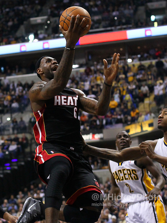 Feb. 15, 2011; Indianapolis, IN, USA; Miami Heat small forward LeBron James (6) puts the ball up against the Indiana Pacers at Conseco Fieldhouse. Mandatory credit: Michael Hickey-US PRESSWIRE