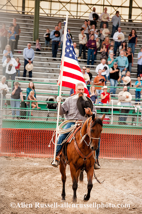 Will James Roundup, Ranch Rodeo, American Flag, Opening Ceremony, Dwight Hill; Hardin, Montana, MODEL RELEASED, PROPERTY RELEASED horse & rider