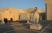 Sculpture by Salim Almarhoon (right), in the sculpture courtyard at the Bahrain National Museum, designed by Krohn and Hartvig Rasmussen, inaugurated December 1988 by Amir Shaikh Isa Bin Salman Al-Khalifa, in Manama, Bahrain. The museum houses cultural and archaeological collections covering 6000 years of history, with rooms entitled Burial Mounds, Dilmun, Tylos and Islam, Customs and Traditions, Traditional Trades and Crafts, and Documents and Manuscripts. Picture by Manuel Cohen