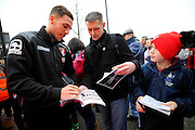 AFC Bournemouth midfielder Dan Gosling signing autographs outside the Vitality Stadium before The FA Cup match between Bournemouth and Everton at the Goldsands Stadium, Bournemouth, England on 20 February 2016. Photo by Graham Hunt.