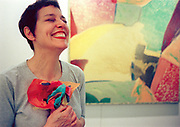 """Artist Margaret Sands is delighted with a crepe-paper bouquet given to her by one of the children at the valentine-making workshop taught by Sands and artist Miki Hsu Leavey Saturday afternoon at the Napa Valley Museum.  """"This is the kind of thing that makes my heart race,"""" Sands said. SAMANDA DORGER/REGISTER"""