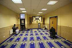 © Licensed to London News Pictures. 07/02/2015. Leeds, UK. Worshipers inside Leeds Grand Mosque in West Yorkshire as mosques all over Britain open their doors to non-muslims to explain their faith beyond the hostile headlines. This is the second 'Visit My Mosque Day' with the first being last year. Organised by the Muslim Council of Britain, last year's event attracted hundreds of visitors for tours, talks and tea. Photo credit : Ian Hinchliffe/LNP