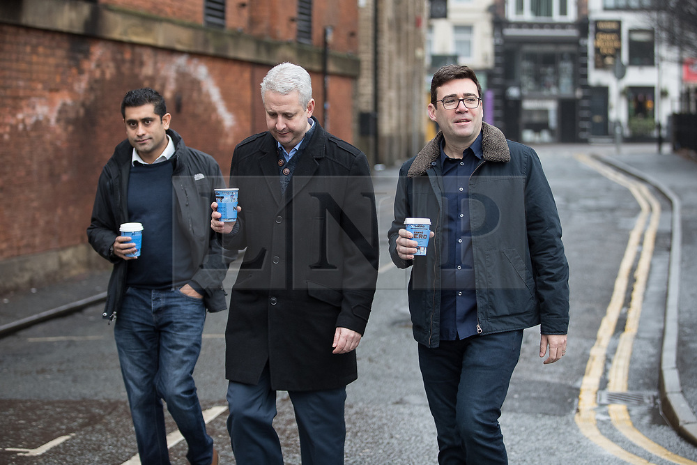"© Licensed to London News Pictures. Manchester , UK . FILE PICTURE DATED 07/01/2017 of RISHI SHORI (leader of Bury council) , IVAN LEWIS MP and ANDY BURNHAM carrying Caffe Nero coffees when arriving for a campaign launch event for Andy Burnham's candidacy of Mayor of Greater Manchester, at the Mechanics' Institute in Manchester. Mr Burnham wrote on twitter "" Bit bizarre hearing these right-wing calls for a 'Barista Visa'. God forbid the idea of waiting longer in the morning for their posh coffee "". Photo credit: Joel Goodman/LNP"