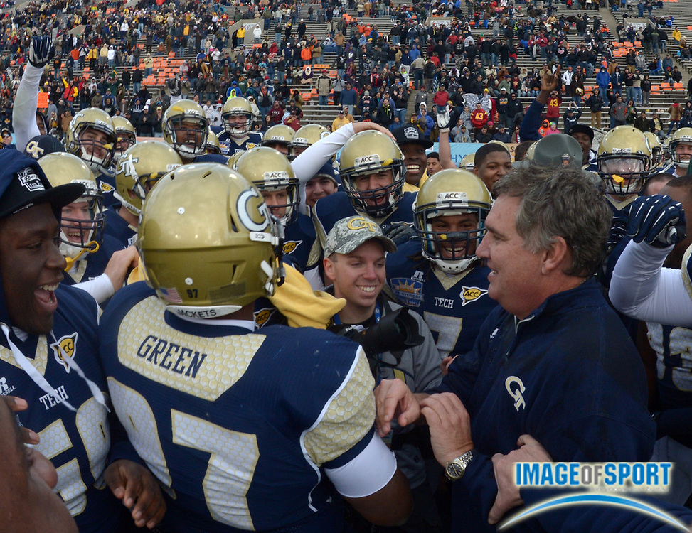 Dec 31, 2012; El Paso, TX, USA; Georgia Tech Yellow Jackets coach Paul Johnson celebrates in the final minute against the Southern California Trojans in the 2012 Sun Bowl at Sun Bowl Stadium. Georgia Tech defeated USC 21-7.
