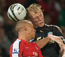 LONDON, ENGLAND - Wednesday, October 28, 2009: Liverpool's Dirk Kuyt and Arsenal's Mikael Silvestre during the League Cup 4th Round match at Emirates Stadium. (Photo by David Rawcliffe/Propaganda)