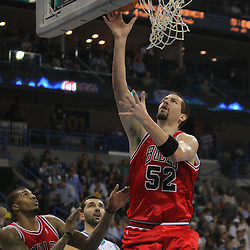Jan 29, 2010; New Orleans, LA, USA; Chicago Bulls center Brad Miller (52) shoots over New Orleans Hornets forward Peja Stojakovic (16) during the first half at the New Orleans Arena. Mandatory Credit: Derick E. Hingle-US PRESSWIRE