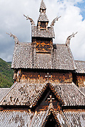 """Dragon head design motif. The 12th century Borgund Stave Church (stavkirke or stavkyrkje) is the best preserved of Norway's 28 remaining stave churches. """"Staves"""" are upright logs that support the central room framework. Borgund is a triple nave stave church of the Sogn-type. Location: Borgund, Lærdal municipality, Sogn og Fjordane county, Norway"""