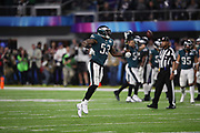 Philadelphia Eagles outside linebacker Nigel Bradham (53) leaps and celebrates after a strip sack fumble caused by Philadelphia Eagles defensive end Brandon Graham (55) that sets up an Eagles field goal late in the fourth quarter during the 2018 NFL Super Bowl LII football game against the New England Patriots on Sunday, Feb. 4, 2018 in Minneapolis. The Eagles won the game 41-33. (©Paul Anthony Spinelli)