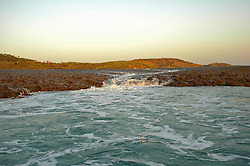 An outgoing tide sends water cascading from Turtle Reef in Talbot Bay on the Kimberley coast.