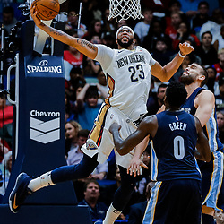 Jan 20, 2018; New Orleans, LA, USA; New Orleans Pelicans forward Anthony Davis (23) attempts a dunk over Memphis Grizzlies forward JaMychal Green (0) and center Marc Gasol (33) during the first half at the Smoothie King Center. Mandatory Credit: Derick E. Hingle-USA TODAY Sports