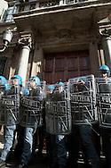 Roma 24 Novembre 2010.Manifestazione degli studenti universitari contro il Ddl Gelmini  e contro  i tagli all'università e alla ricerca.I studenti tentano di entrare nel Palazzo del Senato.La Polizia davanti al Senato.Rome November 24, 2010. Demonstration of university students  against  Ddl Gelmini and against cuts to university and research. The students try to enter the Palace of the Senate