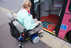 Woman wheelchair getting on the bus,