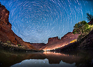 Star trails over the desert and Colorado River near Moab, Utah.