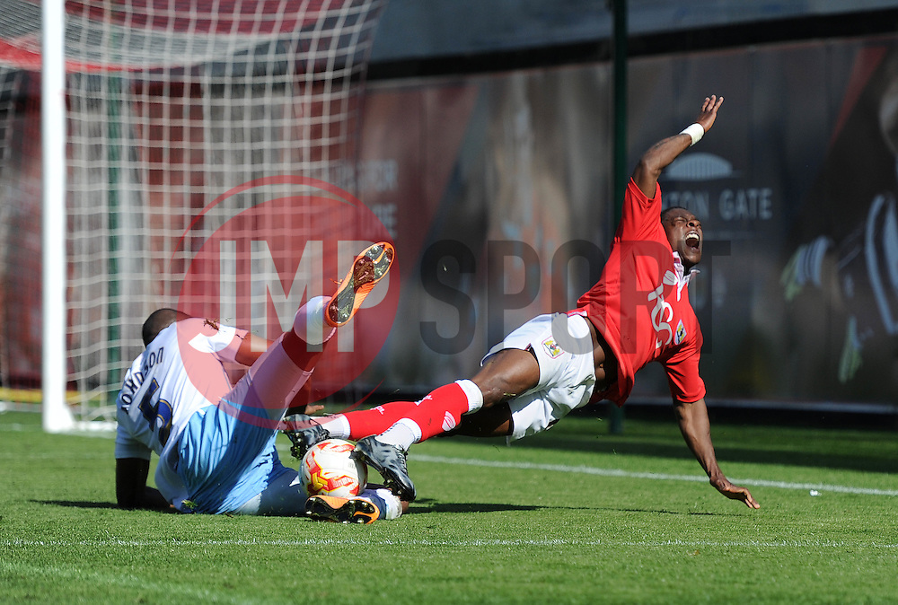 Bristol City's Kieran Agard is tackled by Coventry City's Reda Johnson - Photo mandatory by-line: Dougie Allward/JMP - Mobile: 07966 386802 - 18/04/2015 - SPORT - Football - Bristol - Ashton Gate - Bristol City v Coventry City - Sky Bet League One