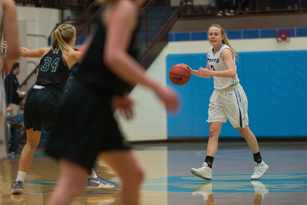 Medford/Somerville, MA - Sophomore guard Jac Knapp dribbles during Tufts' 64-44 2nd round championship win against Husson at Cousens Gymnasium on Mar 4, 2017. (Ray Bernoff / The Tufts Daily)
