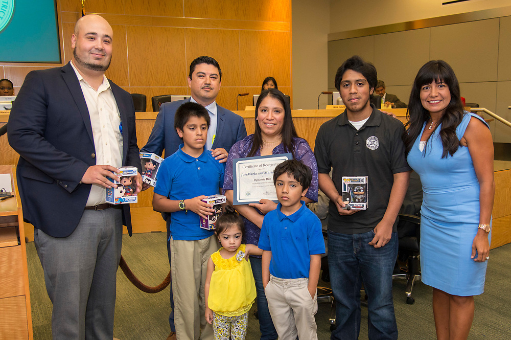 Houston ISD Trustee Diana Davila poses for a photograph with Maria Perez and her family during a Houston ISD Board of Trustee meeting, May 11, 2017.