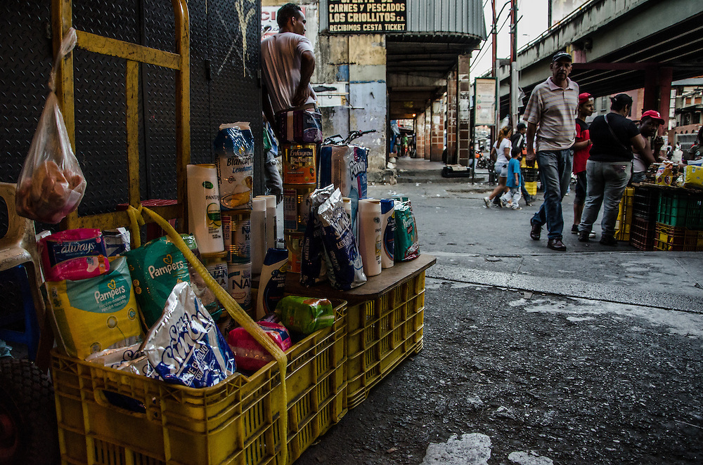 CARACAS, VENEZUELA - JANUARY 10, 2016: Shoppers come to the black market in Petare slum on the outskirts of Caracas to buy hard-to-find products such as soap, shampoo, corn flour, rice, coffee, cooking oil and diapers. All of these items are regulated by government price controls in supermarkets and pharmacies, often times at prices lower than they cost to produce or import -- which leads to shortages. In Petare, vendors illegally re-sell the items at exponentially higher prices, taking advantage of the high demand of hard-to-find products.  PHOTO: Meridith Kohut for The New York Times // For Nick Casey's Caracas Blog post Venblog8