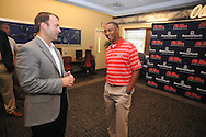 Ole Miss athletic director Ross Bjork (left) talks with Brian OÕNeal, who was named the new track coach at Ole Miss during a press conference in Oxford, Miss. on Tuesday, June 12, 2012.
