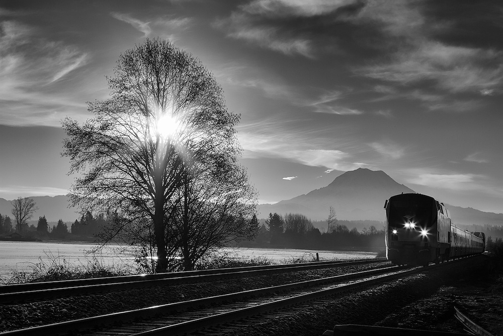As the winter sun rises over the Cascades, its warm rays start to melt the morning frost and fill the valley with a light fog that glows from the sun. It's a serene and beautiful morning that comes awake with the sounds of Amtrak's namesake Cascade service, blasting through the valley on it's way south to Portland.