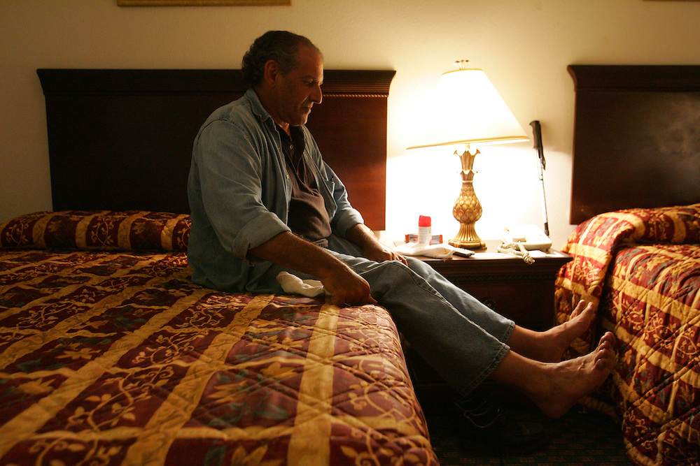 Jay Johnson Castro rests at a La Quinta hotel in Olmito, just outside of Brownsville, at the end of day 14 of his walk to protest the border wall.