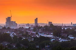 """© Licensed to London News Pictures. 17/09/2020. Leeds UK. The sun sets over the City of Leeds in West Yorkshire last night as the city is poised to be added to the list of areas in England facing stringent coronavirus restrictions. The need for new controls in the West Yorkshire city was discussed at a """"gold command"""" meeting chaired by the health secretary, Matt Hancock, just hours after it emerged that the north-east would be placed under new restrictions. Photo credit: Andrew McCaren/LNP"""