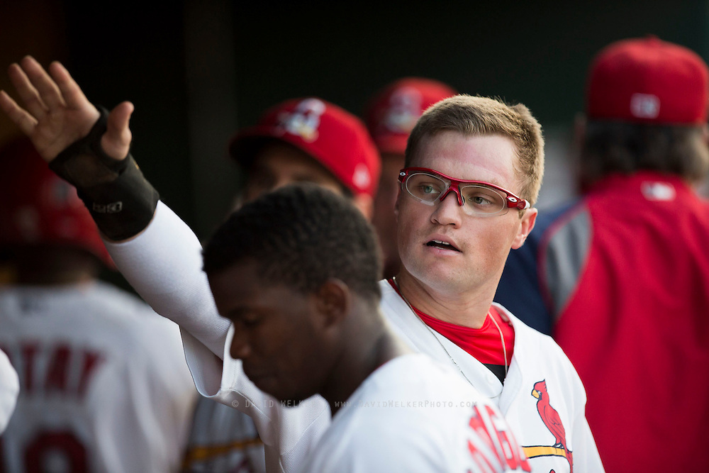 James Ramsey (3) of the Springfield Cardinals high fives teammates in the dugout after scoring during a game against the Northwest Arkansas Naturals at Hammons Field on August 20, 2013 in Springfield, Missouri. (David Welker)