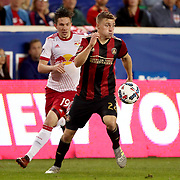 HARRISON, NEW JERSEY- OCTOBER 15: Julian Gressel #24 of Atlanta United challenged by Alex Muyl #19 of New York Red Bulls during the New York Red Bulls Vs Atlanta United FC, MLS regular season match at Red Bull Arena, Harrison, New Jersey on October 15, 2017 in Harrison, New Jersey. (Photo by Tim Clayton/Corbis via Getty Images)