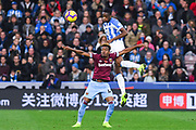 Terence Kongolo of Huddersfield Town (5) rises above Grady Diangana of West Ham United (45) to head the ball clear during the Premier League match between Huddersfield Town and West Ham United at the John Smiths Stadium, Huddersfield, England on 10 November 2018.
