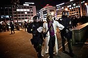 Frankfurt am Main | 02 Feb 2015<br /> <br /> Am Montag (02.02.2015) demonstrierten in Frankfurt an der Hauptwache etwa 60 PEGIDA-Anh&auml;nger mit teils extrem rassistischen Reden und Parolen z.B: gegen &quot;Islamisierung&quot;, an den Aktionen gegen die Rechtsextremisten nahmen mehrere tausend Menschen teil.<br /> Hier: Polizeibeamte f&uuml;hren einen Gegendemonstranten ab, die angeblich mit einer Flasche geworfen hat.<br /> <br /> &copy;peter-juelich.com<br /> <br /> [No Model Release | No Property Release]
