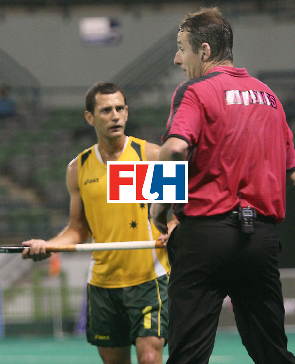 Kuala Lumpur:   Jaime  Dwyer of Australia gets a green card from umpire  Simmonds Garry in the match against Korea in the Samsung Hockey Men Champions Trophy on Nov 30th, 2007.  Photo:GNN/Vino John