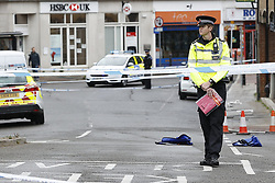 © Licensed to London News Pictures. 10/06/2020. Leatherhead, UK. Police at the scene in Leatherhead, Surrey after a body was found. Officers were called to North Street in Leatherhead shortly after 6am this morning following the discovery of a man's body. Enquiries are ongoing at a number of locations in the area. Local reports say that the body may have been found in a block of flats off the High Street. Photo credit: Peter Macdiarmid/LNP