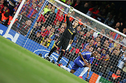 Victor Valdes of Barcelona signals to his defence as a dejected Didier Drogba reacts after missing out on a penalty during the UEFA Champions League Semi Final Second Leg match between Chelsea and Barcelona at Stamford Bridge on May 6, 2009 in London, England.