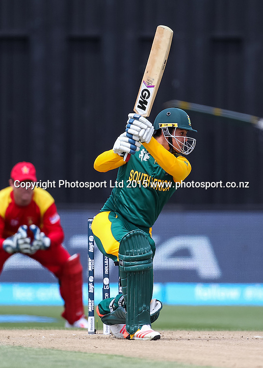 South Africa's Quinton de Kock hits a boundary during the ICC Cricket World Cup match - South Africa v Zimbabwe at Seddon Park, Hamilton, New Zealand on Sunday 15 February 2015.  Photo:  Bruce Lim / www.photosport.co.nz