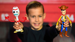 """© Licensed to London News Pictures. 13/11/2019. LONDON, UK. Charlie (aged 10) plays with Forky and Woody from Toy Story 4 True Talkers by Mattel at the preview of """"DreamToys"""", the official toys and games Christmas Preview, held at St Mary's Church in Marylebone.  Recognised as the countdown to Christmas, the Toy Retailer's Association, an independent panel of leading UK toy retailers, have selected the definitive and most authoritative list of which toys will be the hottest property this Christmas.  Photo credit: Stephen Chung/LNP"""