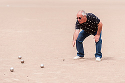 "© Licensed to London News Pictures. 05/06/2015.   London, UK. A French coach gives advice, as media and guests take part in ""Freddie for the Day"", some dressing up as Queen's lead singer, Freddie Mercury, by playing a special game of celebrity Pétanque, competing for the Londonaise 'Celebrity Pétanque Trophy', ahead of The Londonaise Pétanque festival this weekend in Barnard Park, Islington.  The festival will set a new precedent in the UK with 128 teams taking part in the main tournament.  The event also aims to raise funds for the Mercury Phoenix Trust to fight against AIDS worldwide. Photo credit : Stephen Chung/LNP"