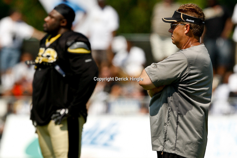 July 31, 2010; Metairie, LA, USA; New Orleans Saints defensive coordinator Gregg Williams watches during a training camp practice at the New Orleans Saints practice facility. Mandatory Credit: Derick E. Hingle