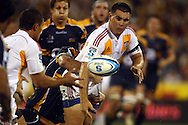 Dwayne Sweeney offloads.Super 14 rugby union match, Brumbies v Cheifs, Canberra, Australia. Saturday 19 February 2011. Photo: Paul Seiser/PHOTOSPORT.../SPORTZPICS