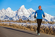 February 24, 2016 - Kelly, WY: Lisa Batchen Smith running in front of the Teton Range near her home in Jackson Hole.