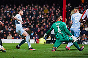Leeds United defender Liam Cooper (6) scores a goal to make the score 1-1 during the EFL Sky Bet Championship match between Brentford and Leeds United at Griffin Park, London, England on 11 February 2020.