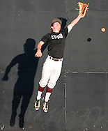 Cy-Fair left fielder Maxx Chrest playfully misses a fly ball during batting practice before a high school baseball playoff game against Cy-Ranch, Friday, May 16, 2014, at Cy-Woods High School in Cypress. (Photo: Eric Christian Smith/For the Chronicle)
