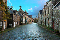Postcard picture of the main street of the village of Locronan, located in Finistere, Brittany, France after the morning showers in winter